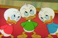 Huey dewey and louie grinning evily in Scrooge's Last Adventure