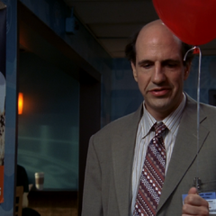 Ted holds a balloon