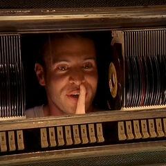 Sean hides in a jukebox
