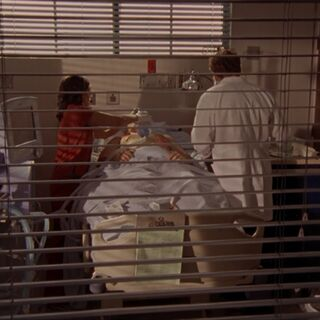 Dr. Cox and Carla unsuccessfully try to save the third and final patient - Dave.