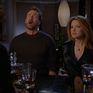 Dr. Cox faints after the Zeltzers place a roofie (rape drug) in his drink...