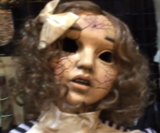 Haunted Wind Up Doll