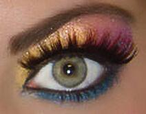 Mac cosmetics rainbow eyeshadow fake eyelashes on a green eye