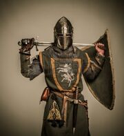 15599718-medieval-knight-with-a-sword-1-