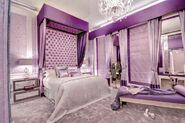 Purple-bedroom-inspiration-for-girls-with-elegant-chandelier-also-big-size-comfort-headboard-940x626