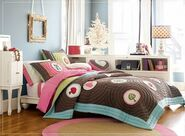 Awesome-girls-bedroom-with-colorfull-bed-cover-and-desk-on-beside-and-carpet-with-the-photo-frames-and-big-windows-with-curtain