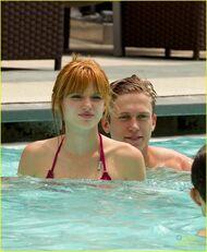 Bella-thorne-pink-bikini-with-boyfriend-in-the-pool