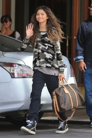 Zendaya-coleman-wavy-hair-army-style-top