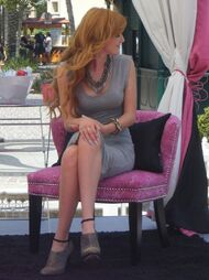 Bella-thorne-sitting-down-silver-dress