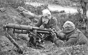British Vickers machine gun crew with gas masks
