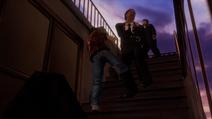 Ryo kicks black suit