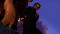Ryo kicked by black suit
