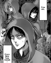 Armin, Eren y Mikasa viajan entre el bosque