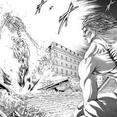 El Titán Martillo de Guerra aparece frente a Eren.