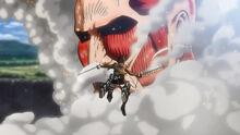 Eren salta para atacar al Titán Colosal