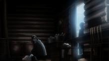 Grisha examinando los cuerpos muertos