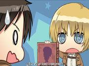 Armin le muestra el libro a Eren