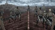 Mikasa alentando a sus compañeros
