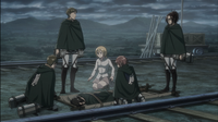 Hange's squad and Historia surround an unconscious Ymir