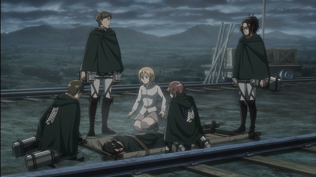 File:Hange's squad and Historia surround an unconscious Ymir.png
