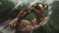 Reiner punches Eren