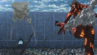 The Colossal Titan kicks Eren