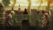 Eren affrontant Annie dans Stohess