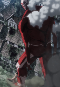 Eren grabs the Colossal Titan's leg