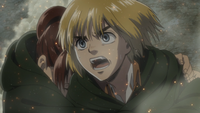 Armin watches Eren get taken away