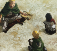 Hannes comforts Armin and Mikasa
