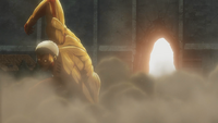 An armored Titan destroys the gate
