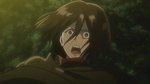 Mikasa watches as the Female Titan captures Eren