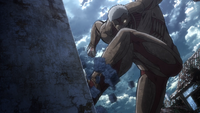 The Armored Titan begins climbing the Wall