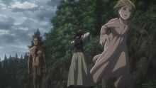 Sasha protects a child from the attack of a Titan