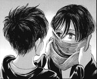 Eren wraps his scarf around Mikasa
