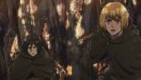 Armin and Mikasa watch as Ymir eats Christa
