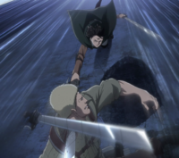 Reiner is attacked by Levi