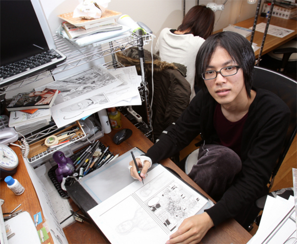 File:Isayama at his desk.png