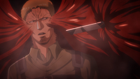 Reiner removes the blade from his neck