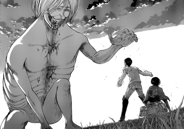 File:The Smiling Titan reaches for Eren and Mikasa.jpg