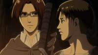 Hange holds up the book Erwin gave them