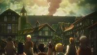 Die Bürger Shiganshinas sehen den kolossalen Titanen
