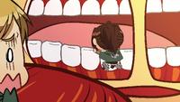 Hange inspects the Titan's teeth