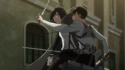Livaï arrêtant Mikasa