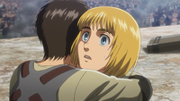 Eren surprises Armin with a hug