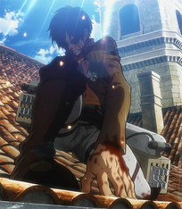Injured Eren stands up