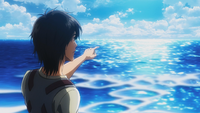 Eren pensively points at the sea