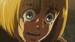 A traumatized Armin cries