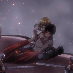 Armin ayuda a Eren a salir de su titán.