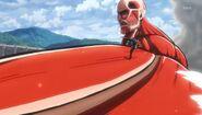 Eren court sur le titan colossal